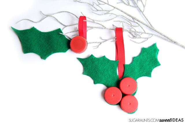 Make this bottle caps holly craft using recycled bottle caps for a fun Christmas tree holly ornament, a gift topper, or a holiday wreath.