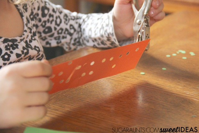 Address fine motor skills like strengthening and scissor skills with this fine motor lantern craft for kids.