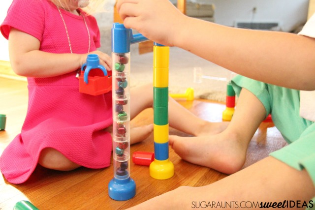 Put jingle bells in the marble run for a fun way to work on visual tracking skills.