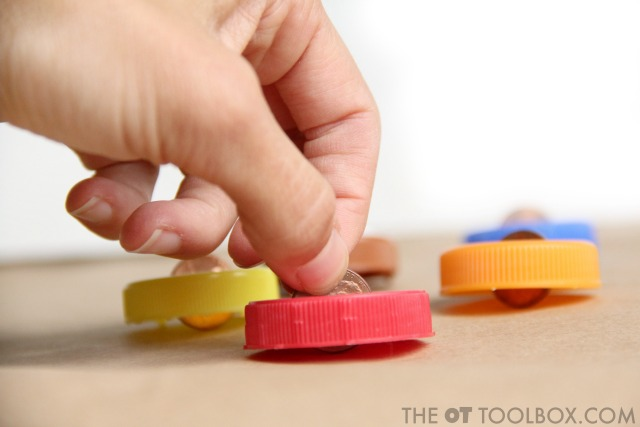 Neat pincer grasp with a DIY spinning top for addressing fine motor skills