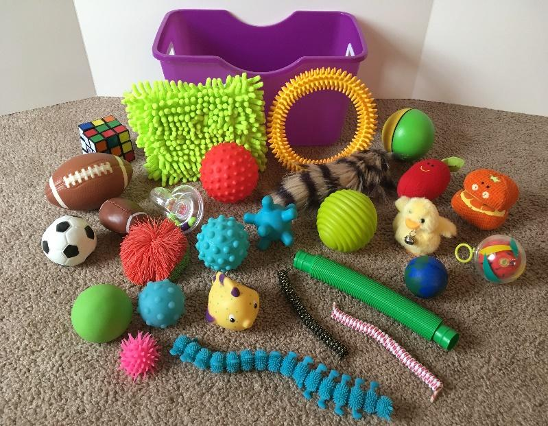 Make an occupational therapy activity toolkit to address attention or self-regulation needs using sensory fidget tools and other items used in pediatric OT.