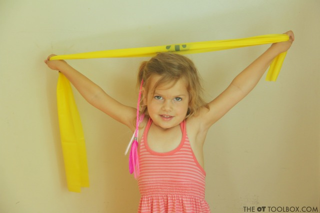 THerapy band exercise program for kids to boost strength, core strength, and sensory needs.