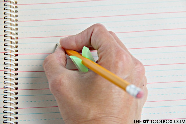 Clip a clothespin onto a pencil to help kids with pencil grasp as a physical cue for better grip on the pencil when writing.