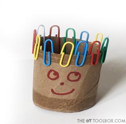 Use paper clips and a paper towel tube to make a paperclip man, a fun fine motor activity for kids to work on fine motor skills as part of a back-to-school fine motor toolkit that works on fine motor skills in a fun way!