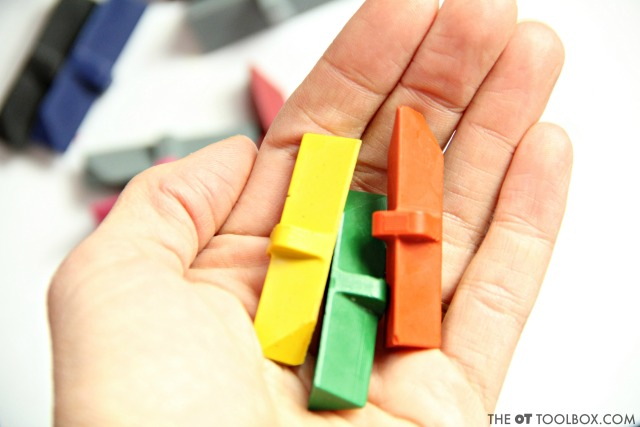 Play the 3 crayon challenge in occupational therapy activities to work on fine motor skills, pencil grasp, and hand strength.