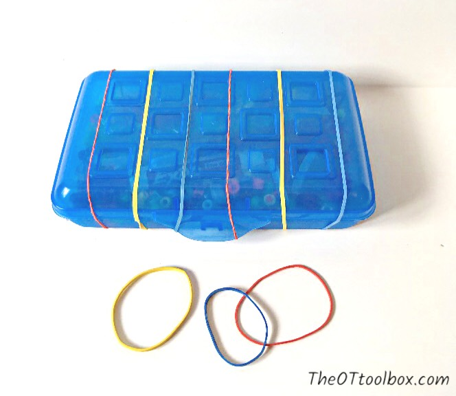 Use a pencil box in pediatric occupational therapy activities to improve skills like strength and bilateral coordination in occupational therapy activity.
