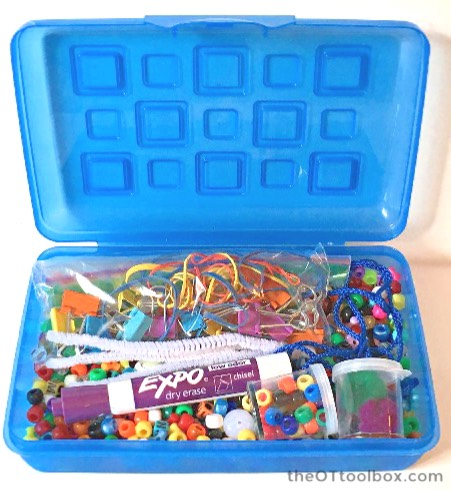 Use a pencil box as a pediatric occupational therapy activity toolbox when filling it with fine motor items and other tools to improve fine motor skills.