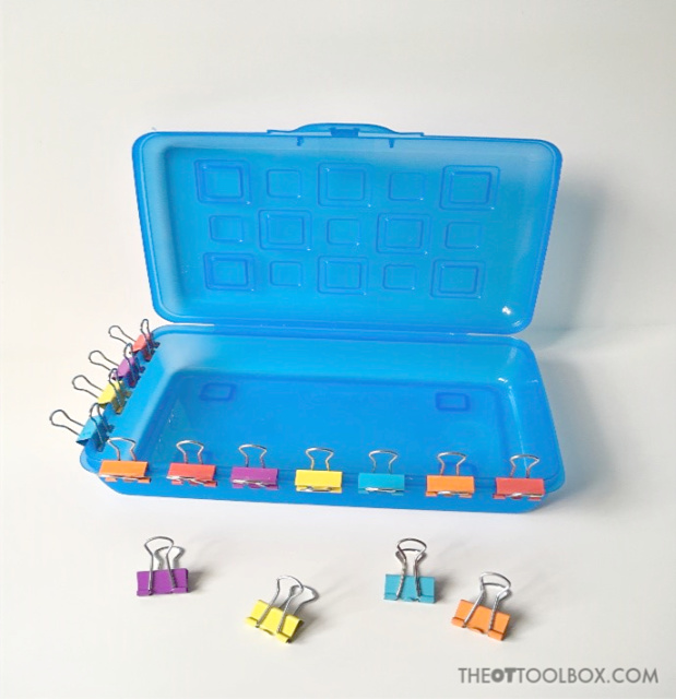 This pediatric occupational therapy activity uses binder clips and a pencil box to improve bilateral coordination skills and fine motor skills in occupational therapy with kids.