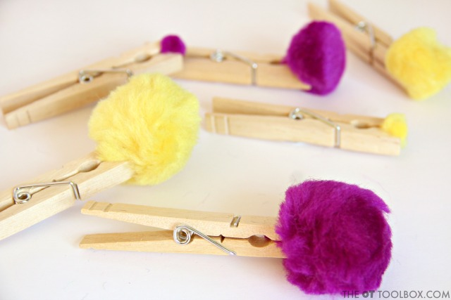 Use craft pom poms and clothes pins to work on fine motor skills in kids.