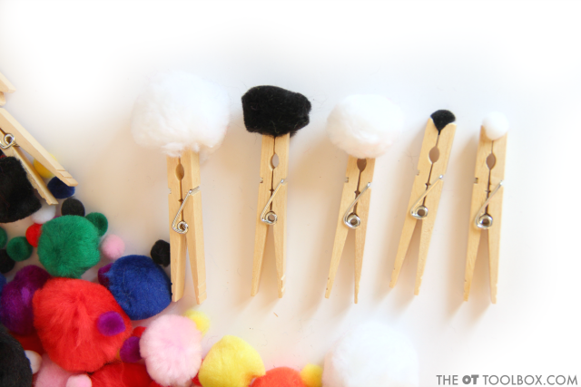 Kids can work on visual perceptual skills and fine motor skills using craft pom poms and clothes pins.