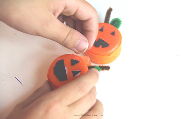Use orange washi tape to make a mini pumpkin craft.