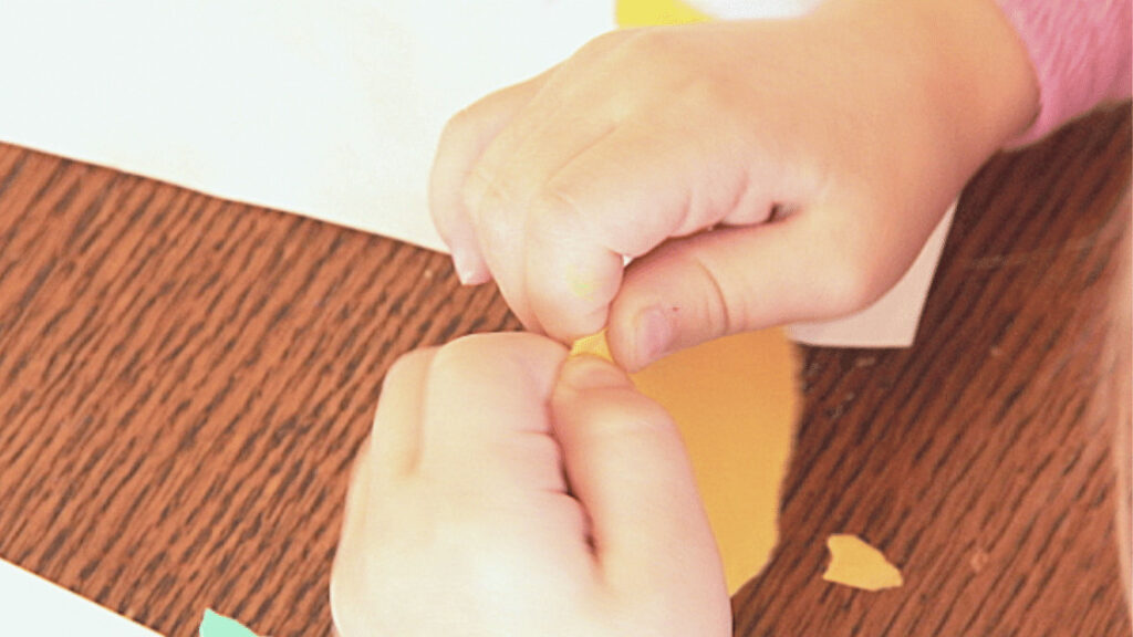 Tear a piece of paper to help kids strengthen fine motor skills.
