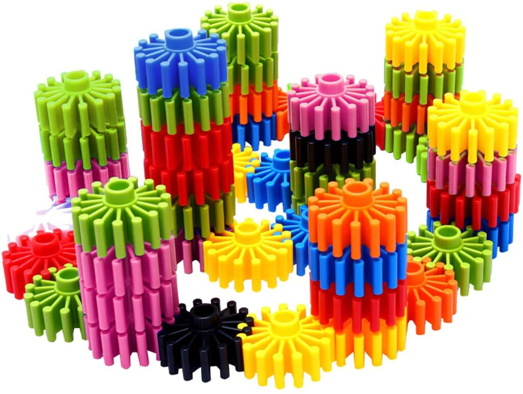 Use these gear building toys to help kids develop fine motor skills like hand strength.